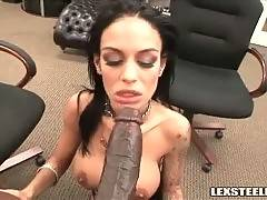Hot looking tattooed brunette eagerly sucks black rod.